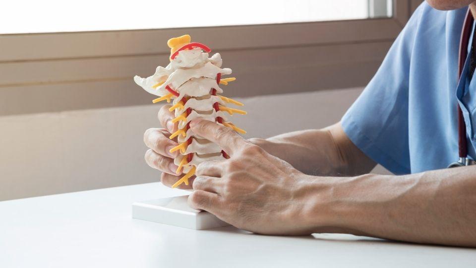 Man holding spine